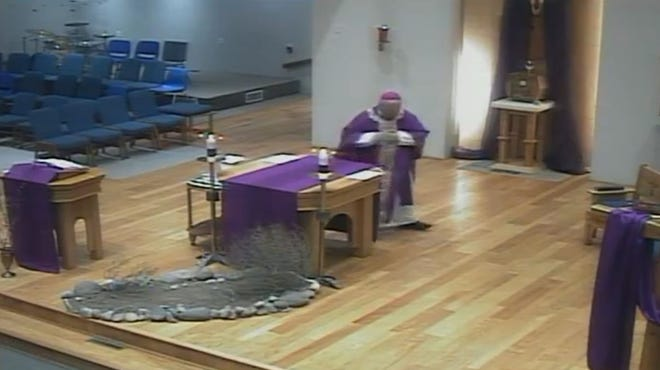 Las Cruces Diocese Bishop Peter Baldacchino prepares to deliver Mass on Friday, April 3, 2020, in an empty church. The service was live-streamed on the diocese's social media pages.