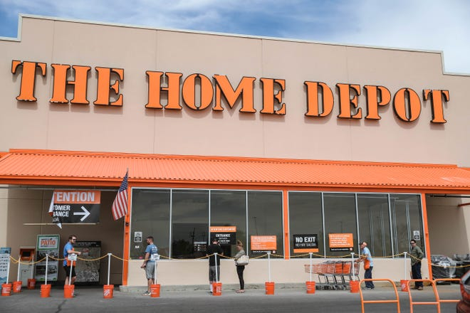 The Las Cruces Home Depot lets in 150 people at a time as a few shoppers wait in line to enter the store on Friday, April 3, 2020.