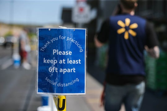 Walmart has posted signs advising customers to stay 6 feet apart in Las Cruces on Saturday, April 4, 2020.