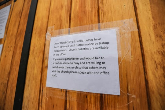 Bishop Peter Baldacchino of the Diocese of Las Cruces canceled public masses on March 16 to mitigate the spread of the COVID-19 coronavirus. A sign notifying parishioners of the closure hangs on the door of the Basilica of San Albino in Mesilla during the public health emergency.
