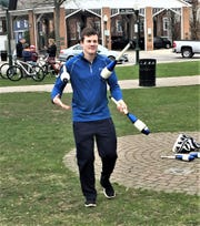 Livonia resident Craig Wise entertained onlookers in Plymouth's Kellogg Park with an hour-long-plus juggling routine.