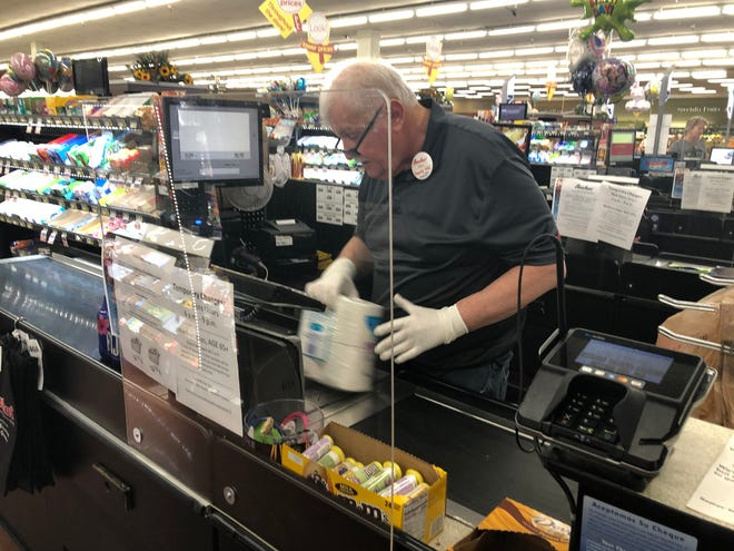 Many supermarkets have installed protection at the checkout counters during the coronavirus pandemic.