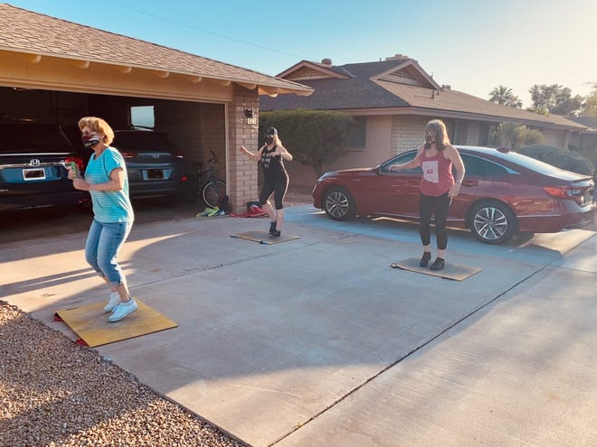 A tap dance lesson in the time of coronavirus with our teacher Regina Pryor, on portable dance floors outside on Rhonda Rhiner's driveway, while wearing masks and practicing appropriate physical distancing, until it got too hot.