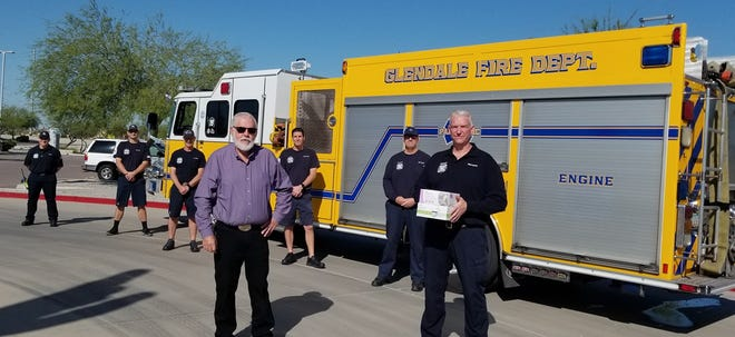 A Glendale Fire Department crew was taken out of service in order to pose with Glendale Mayor Jerry Weiers as he donated 50 masks to the department.