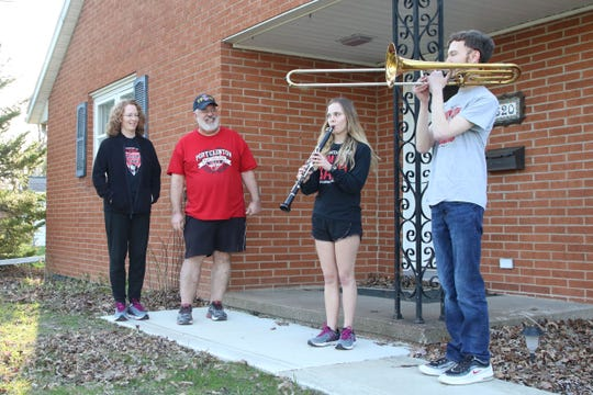 """Port Clinton band director Rod Miller and his wife Kathy watch as their children Ella and Collin play the Port Clinton fight song. Several high school band members and alumni participated in the """"Port Clinton Pride Fridays"""" event."""
