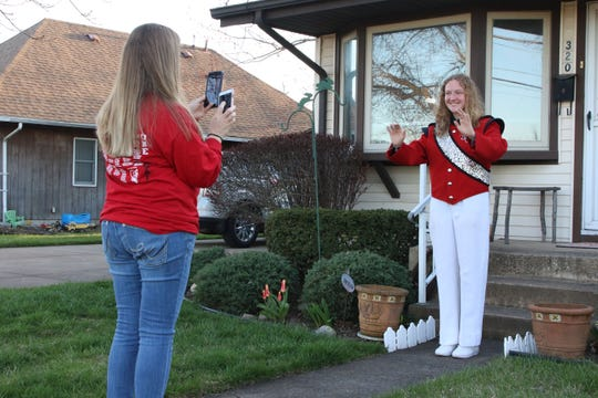 """Senior drum major Caitlin Chafee directs to the music played by her mother Cheryl. Several high school band members and alumni participated in the """"Port Clinton Pride Fridays"""" event."""