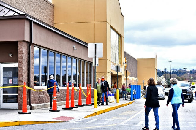 Walmart stages cones for customers to line up outside in preparation for the store reaching new capacity standards in Springettsbury Township, Saturday, April 4, 2020. The measures were taken to limit the potential spread of coronavirus during the pandemic. Dawn J. Sagert photo