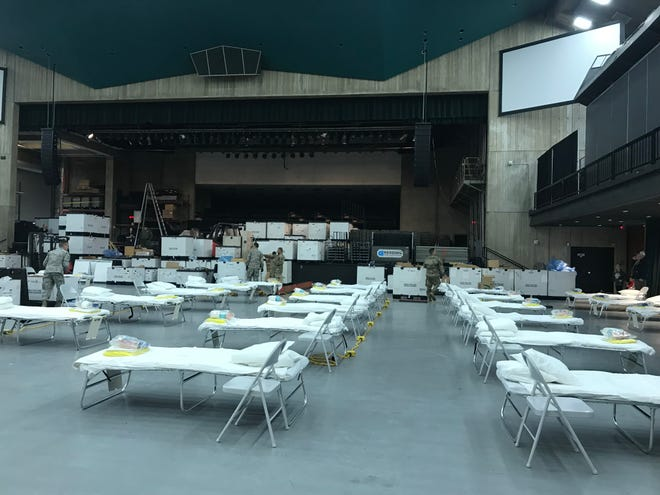Some of the 125 beds set up in the North State Medical Field Station, the new pop-up hospital to offset a surge of coronavirus patients at the city's existing facilities. The National Guard began the set up Saturday, April 4, 2020 at the Redding Civic Auditorium.