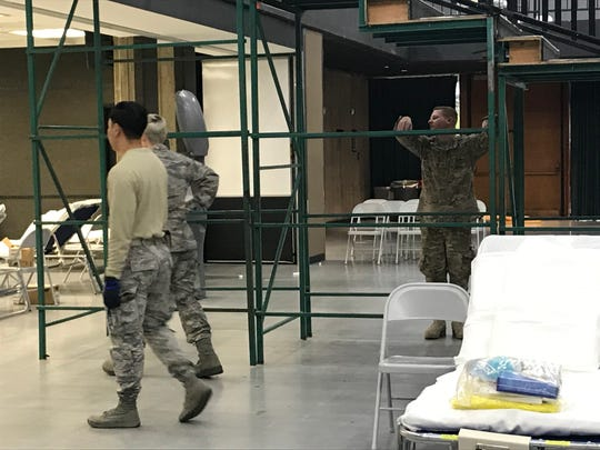 National Guard members position items in the new field hospital on Saturday, April 4, 2020 at the Redding Civic Auditorium.