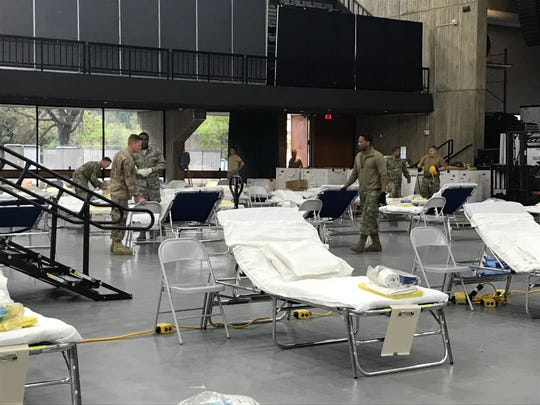 National Guard members set up and organize a field medical station inside the Redding Civic Auditorium on Saturday, April 4, 2020.