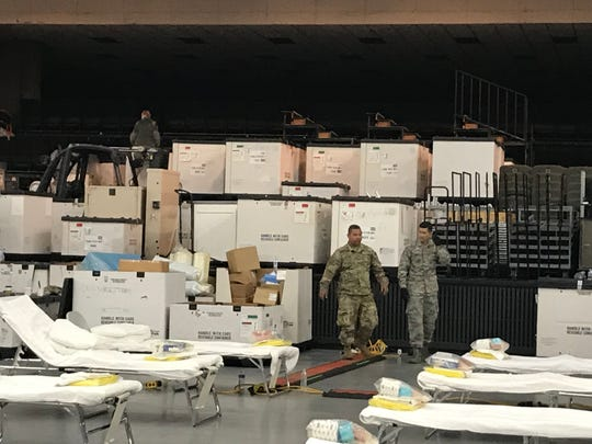 National Guard members on Saturday, April 4, 2020 deal with a stash of supplies to be set up at the Redding Civic Auditorium's new field hospital.