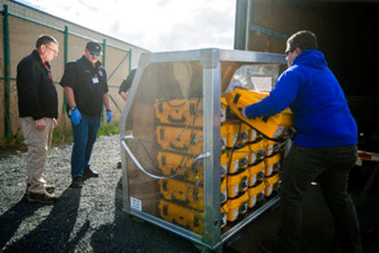 Tony Miller, Yakima County emergency management director; Horace Ward, operations manager of Yakima Valley Office of Emergency Management; and Blake Scully, a resource supply officer, from left, evaluate how many ventilators arrived from the weekly supply shipment  April 2, 2020, at the Yakima County Office of Emergency Management in Union Gap, Wash.