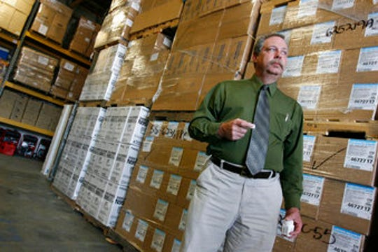 In this April 29, 2009, file photo, Don Wood, an official with the Strategic National Stockpile, awaits another truckload of medications in Salt Lake City during a swine flu outbreak from the H1N1 virus. The 2009 H1N1 pandemic prompted the largest use to date of the stockpile, which was created in 1999. It has never confronted anything on the scale of the current COVID-19 pandemic.