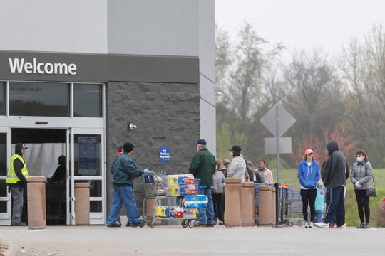 People line up outside of the Sam's Club at 745 W. El Camino Alto St., on Saturday, April 4, 2020. Many stores like Walmart and Target are limiting the number of shoppers who can enter the store in an effort to help slow the spread of the novel coronavirus.