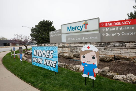 "A sign outside of Mercy Hospital reads, ""Heroes Work Here"" as a show of support to healthcare workers during the novel coronavirus pandemic."