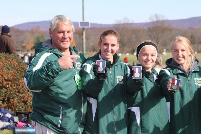 Gary Kessler celebrates with his medal winners following a race.