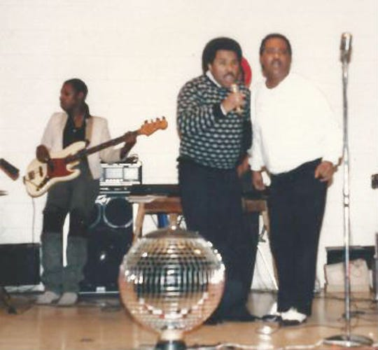 Wayne Sharrock (right) performs a duet with former singing partner Jimmy Bason during an event in Ossining, New York in the early 1980s. Sharrock's cousin, Kendall Buchanan plays the bass guitar in the background.