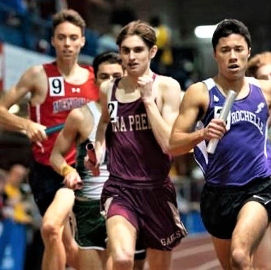 Iona Prep's Michael DeStasio runs in a relay at The Armory, including against former grade school teammate Tristan Marine (r) of New Rochelle. DeStasio plans to run next year for SUNY-Cortland.