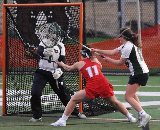 Megan Dineen of Somers scoring against Brewster. Dineen will play for Albany next year.