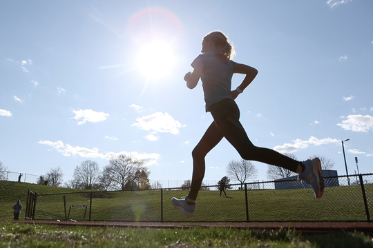 Mallory Holloway works out on the McKean High School track.  The Conrad freshman has found success in cross country and track despite being born with cystic fibrosis.