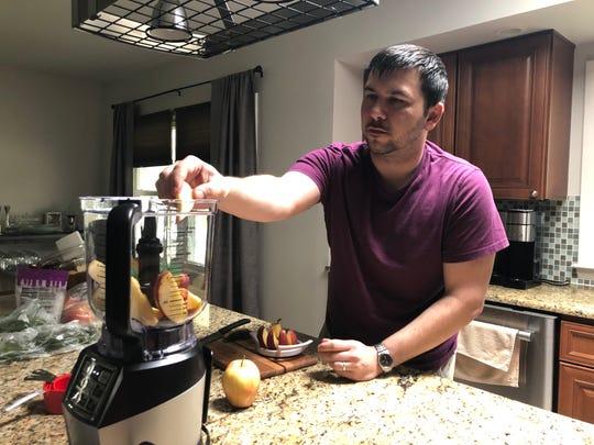 Dan Devlin makes charoset, an apple and nut spread often eaten on matzah during Passover.