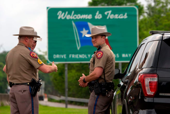 Texas Gov. Greg Abbott authorized state troopers to assist the U.S. Border Patrol in enforcing federal immigration laws. More than 4,600 people suspected of crossing into the USA without proper documentation have been arrested this year under Operation Lone Star.