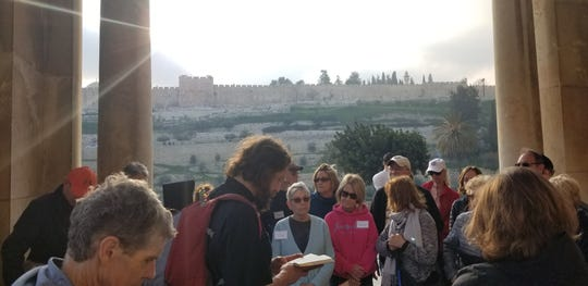Rev. Dave Swantek (center) leads a group reflection during a pilgrimage to the Holy Land last year for members of St. Martha Parish.