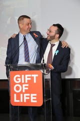 Scott Novorr (left) and Binyoming Gewirtz (right) embrace after meeting in person for the first time. In Nov. 2018, Gewirtz donated bone marrow to save Novorr's life. It was the second time Gewirtz, a Lakewood resident, was able to give a little bit of himself, in the shape of bone marrow, to give a stranger a chance to live.