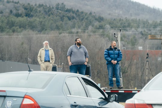 Pastors Roger Wotton, Travis Moses and Marty Bascom participate in a drive-in church service in Randolph on April 5, 2020.
