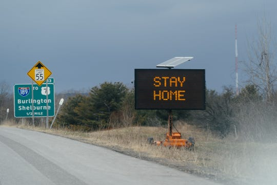 "A sign beside Interstate 89 publicizes Vermont Gov. Phil Scott's ""Stay Home, Stay Safe"" order on April 5, 2020."