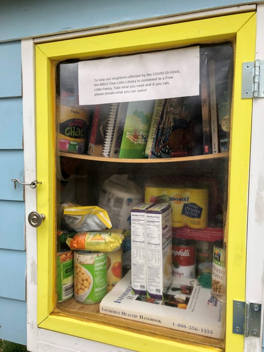 Pasta, beans, flour and other shelf-stable items are offered for free in a Free Little Library in Haddon Township. Books can still be enjoyed off of the top shelf and will be replenished as needed.