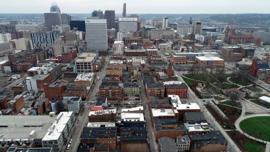 Car and foot traffic is light at lunch time in the Over-the-Rhine neighborhood of Cincinnati on Tuesday, March 24, 2020. The governor's order to stay inside began at midnight Tuesday.