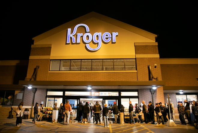 People are lined up at the Kroger in Blue Ash, Ohio just as the doors open 7 a.m. Due to high demand and the need for re-stocking and cleanliness, the chain has reduced hours from 7 a.m. to 9 p.m.,  Tuesday, March 17, 2020.