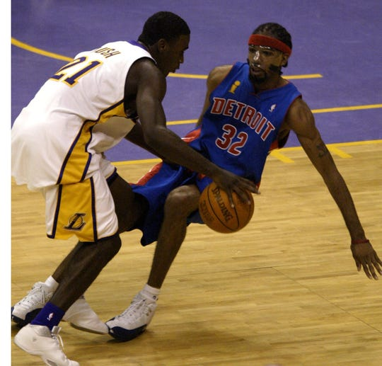 Detroit Pistons' Richard Hamilton takes a charging foul against Los Angeles' Kareem Rush in the fourth quarter in Game 1 of the NBA Finals, Sunday, June 6, 2004 at the Staples Center in Los Angeles.