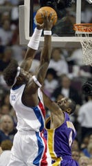 Ben Wallace goes up over Kobe Bryant during the second quarter of Game 5.