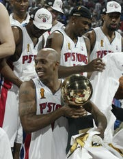 Detroit Pistons' Chauncey Billups holds his Finals MVP trophy after the 100-87 victory over the Lakers to win the NBA championship in Game 5 of the NBA Finals, Tuesday, June 15, 2004 at the Palace of Auburn Hills.