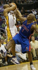 Detroit Pistons' Chauncey Billups ties up Los Angeles Lakers' Derek Fisher during the fourth quarter in Game 1 of the NBA Finals, Sunday, June 6, 2004, at the Staples Center in Los Angeles.