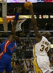 Detroit Pistons' Ben Wallace tries to defend Lakers' Shaquille O'Neal during the first quarter in Game 1 of the NBA Finals, Sunday, June 6, 2004, at the Staples Center in Los Angeles.