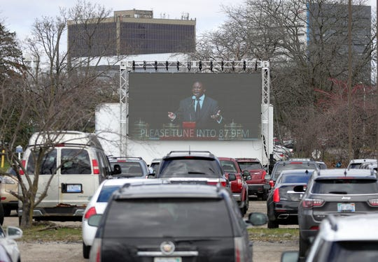Pastor Solomon Kinloch held a drive in service for his congregation at the Triumph Church North Campus due to COVID-19 Sunday, April 5, 2020 in Detroit. About 200-300 people took part watching Kinloch on a big screen located in the church parking lot.