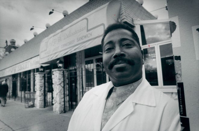 Otis Lee, owner of the former Mr. Fofo's Deli in Detroit, Michigan, is shown in a 1992 photo in front of his store on Second near Hazelwood. He died in April at age 72 of coronavirus.