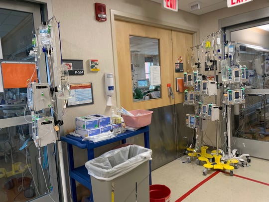 An ingenious solution by the Henry Ford Health System P5 nurses to put pumps outside of rooms using extra tubing to minimize the entry and exit and risk for nursing.