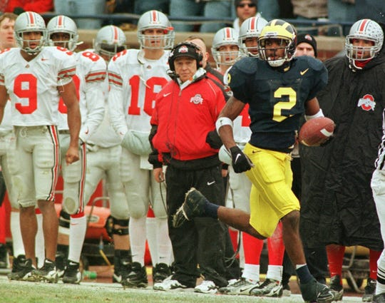 Michigan's Charles Woodson returns a punt 78 yards for a touchdown against Ohio State in 1997.