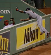 Torii Hunter leaps and misses a catch as David Ortiz hits a grand slam in the eighth inning during Game 2 of the 2013 ALCS.