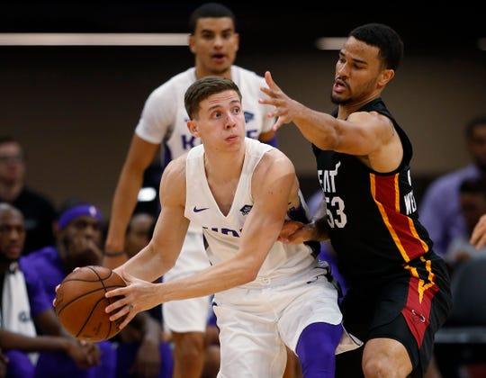 Sacramento Kings guard Kyle Guy, left, said his grandfather died Friday after contracting COvID-19.