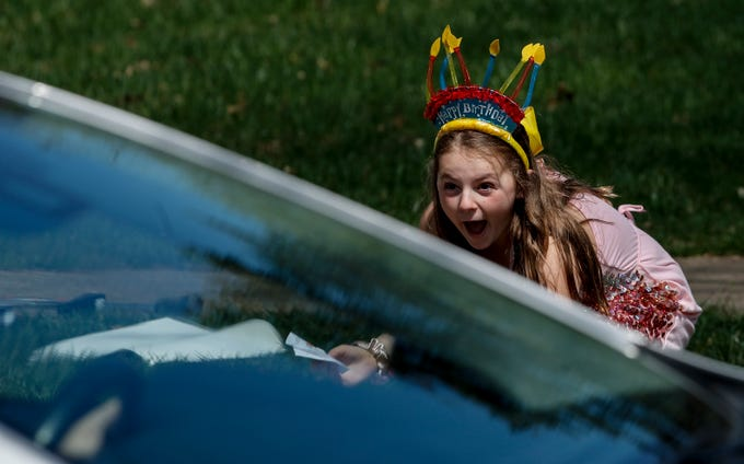 Kennedy Julian celebrates her 12th birthday on the corner of Olde Creek Way and Grand Isle Way. Friends created a parade for her special day during the coronavirus pandemic.