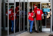 Members of the U.S. Army Corps of Engineers walk into the former Commercial Appeal building to perform an evaluation Sunday, April 5, 2020, on Union Avenue in Memphis.