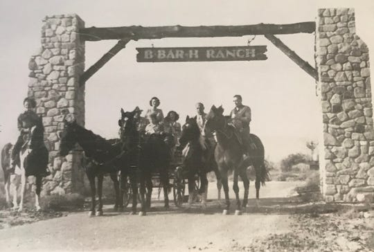 Movie star Peter Lorre, and Jay Kasler on horseback, with little Dick Roger, curl-haired boy, in the wagon with his mom, at B-Bar-H Ranch in 1947.