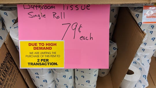 A sign on toilet paper at Saubel's market limits people to two rolls.with each transaction. The Saubels said that one of the lessons they learned was that they wished they had limited product purchases early on.