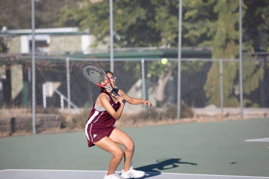 Susy Mesa plays tennis for Sparks High. Susy, 17, played three sports for Sparks High but the track season was cut short amid the COVID-19 pandemic.
