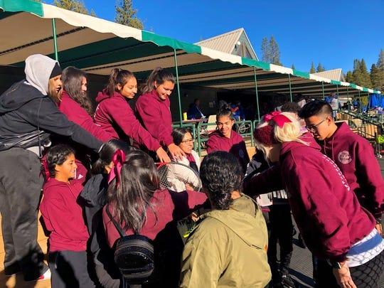 Susy Meza, center, leads a chant. The high school senior's won't finish her last season of sports as schools remain closed amid the coronavirus pandemic.